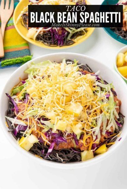 Taco Black Bean Spaghetti in a bowl with toppings